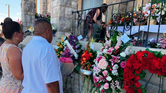 Mourners deliver flowers on Friday, Aug. 16, 2019, for the funeral in El Paso, Texas, of Margie Reckard, 63, who was killed by a gunman in a mass shooting earlier in the month. Hundreds of strangers from El Paso and around the country came to pay their respects Friday after her husband, Antonio Basco, said he felt alone planning her funeral. He invited the world to join him in remembering his companion of 22 years. (AP Photo/Russell Contreras)