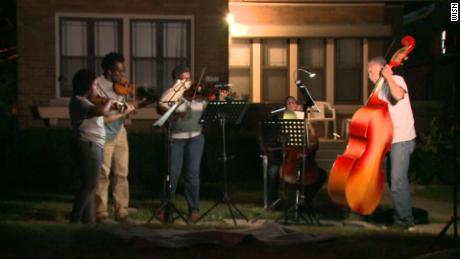 Why this group of musicians plays at crime scenes