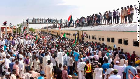 Sudanese demonstrators from the city of Atbara arrive in Khartoum to celebrate the transition to civilian rule.