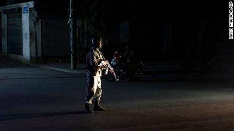 A policeman guards on Sunday after an explosion in Kabul, Afghanistan.
