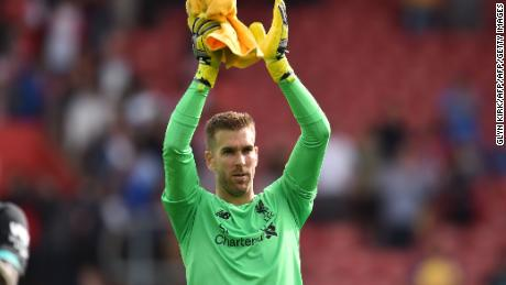 Spanish goalkeeper Adrian applauds Liverpool's supporters after the 2-1 win over Southampton.