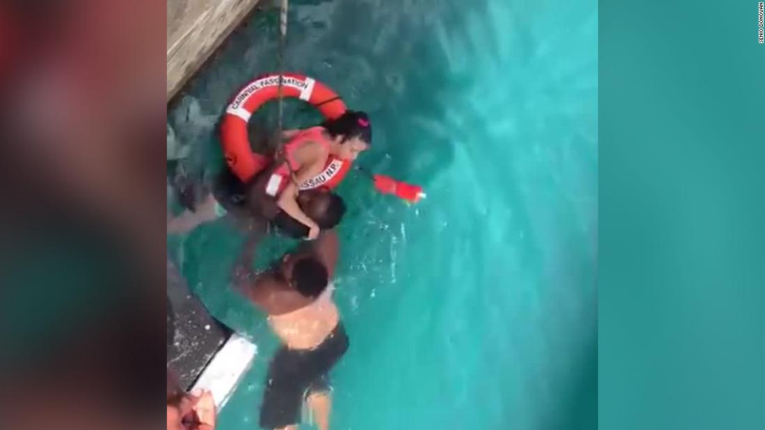 Image result for Girl in wheelchair rescued by stilt dancer after plunging into ocean