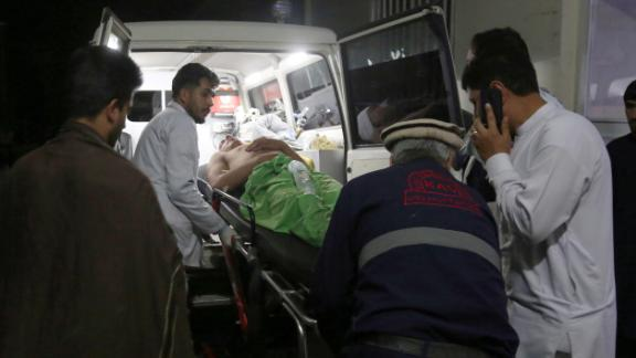 A wounded man is carried to a hospital after an explosion at wedding hall in Kabul, Afghanistan, Sunday, Aug.18, 2019. An explosion ripped through a wedding hall on a busy Saturday night in Afghanistan