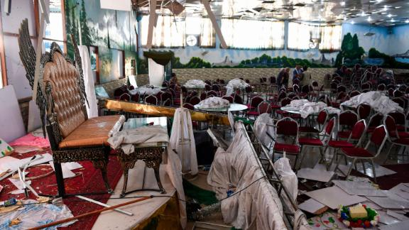 TOPSHOT - Afghan men investigate in a wedding hall after a deadly bomb blast in Kabul on August 18, 2019. - More than 60 people were killed and scores wounded in an explosion targeting a wedding in the Afghan capital, authorities said on August 18, the deadliest attack in Kabul in recent months. (Photo by Wakil KOHSAR / AFP)        (Photo credit should read WAKIL KOHSAR/AFP/Getty Images)