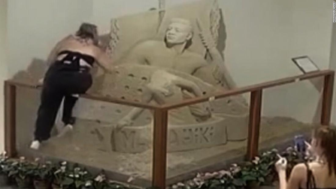 Camera catches person destroying sand sculpture