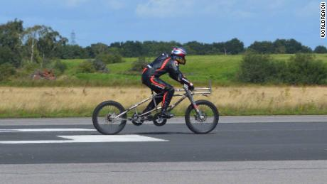 See this man ride a bicycle at a record 174 mph