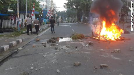 Protesters set fire to cars, tires, and the local parliament building in Manokwari.