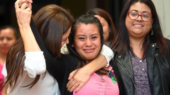 Salvadorean rape victim Evelyn Hernandez (C) celebrates with her lawyers after being cleared of murder after giving birth to a stillborn baby at home in 2016, at Ciudad Delgado