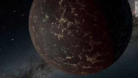 This artist's illustration depicts the exoplanet LHS 3844b, which is 1.3 times the mass of Earth and orbits an M dwarf star. The planet's surface may be covered mostly in dark lava rock, with no apparent atmosphere, according to observations by NASA's Spitzer Space Telescope.