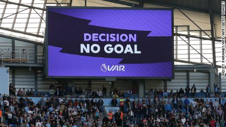 "The big screen displays the ""no goal"" VAR decision to rule out what would have been Manchester City's third goal against Spurs."