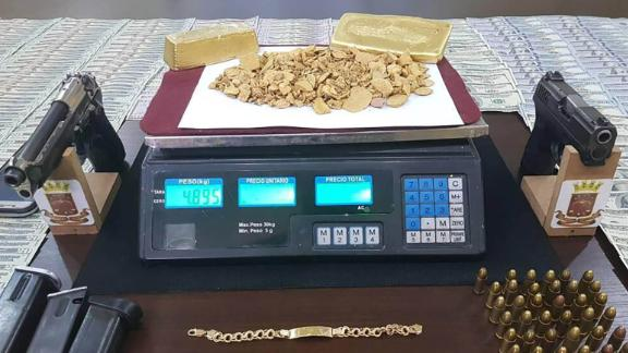 Confiscated weapons and gold from alleged gangs in Bolivar state, near El Callao. Provided to CNN by a senior Venezuelan military source.