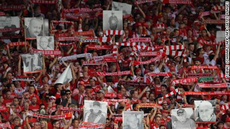 FC Union Berlin's fans show their scarves and pictures of fans who have passed away prior to their match against RB Leipzig in Berlin.