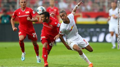 Yussuf Poulsen of RB Leipzig battles with Christopher Trimmel of 1. FC Union Berlin.