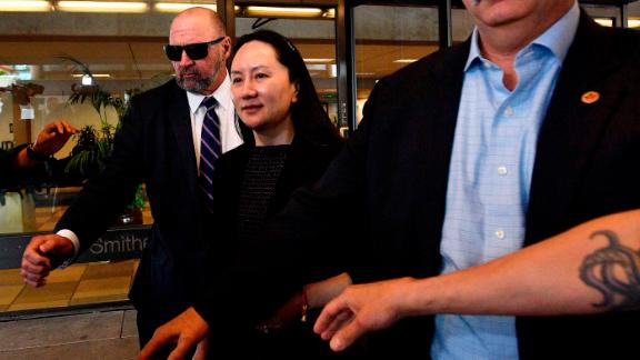 Meng Wanzhou, chief financial officer of Huawei Technologies Co., leaves the Supreme Court following a hearing in Vancouver, British Columbia, Canada, on Wednesday, May 8, 2019. Meng was denied her constitutional rights when she was detained for three hours at the Vancouver airport in December before her arrest at the request of U.S. authorities, her lawyers said. Photographer: Jennifer Gauthier/Bloomberg via Getty Images
