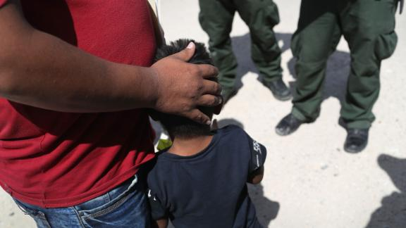 U.S. Border Patrol agents take a father and son from Honduras into custody near the U.S.-Mexico border on June 12, 2018 near Mission, Texas. The asylum seekers were then sent to a U.S. Customs and Border Protection (CBP) processing center for possible separation. U.S. border authorities are executing the Trump administration