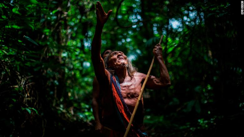 Ororiwa Waiapi walks in the forest near Mogywry village, in Amapa state. The 98-year-old leader is one of the tribe's eldest chiefs.