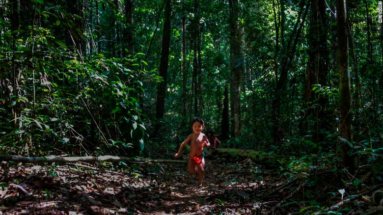 A young Ruwan Waiapi plays in the jungle. Her father, Jawaruwa Waiapi, testified before the United Nations in New York to ask for international support for Brazil's Amazon and the indigenous tribes that live in it.