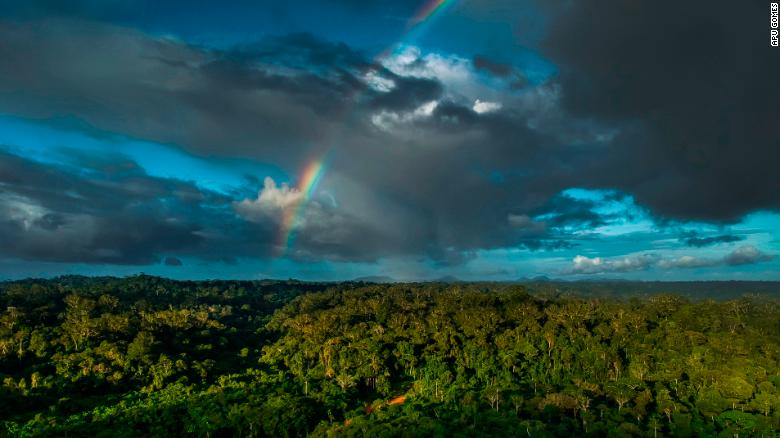 A rainbow shines over Jakare village, in the state of Amapa.