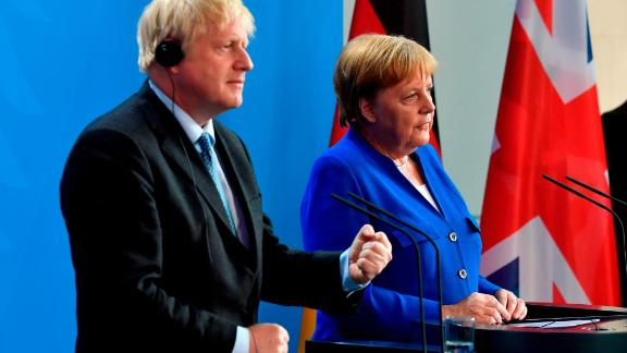 German Chancellor Angela Merkel (R) and British Prime Minister Boris Johnson speak to journalists at the Chancellery on August 21, 2019 in Berlin. - Johnson visits Berlin to kick off a marathon of tense talks with key European and international leaders as the threat of a chaotic no-deal Brexit looms. (Photo by John MACDOUGALL / AFP)        (Photo credit should read JOHN MACDOUGALL/AFP/Getty Images)
