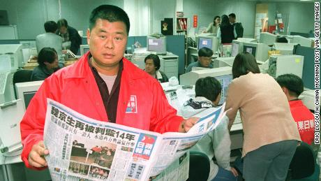 Jimmy Lai with his Chinese-language Apple Daily newspaper, which triggered a price war in 1995.