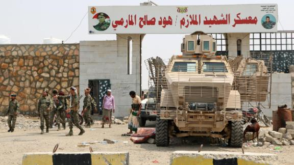 Fighters with the UAE-trained Security Belt Forces loyal to the pro-independence Southern Transitional Council (STC), surround a military vehicle as they gather near the south-central coastal city of Zinjibar in south-central Yemen, in the Abyan Governorate, on August 21, 2019. - Yemeni separatists drove government troops out of two military camps in deadly clashes yesterday, reinforcing their presence in the south after they seized the de facto capital Aden. (Photo by Nabil HASAN / AFP)        (Photo credit should read NABIL HASAN/AFP/Getty Images)