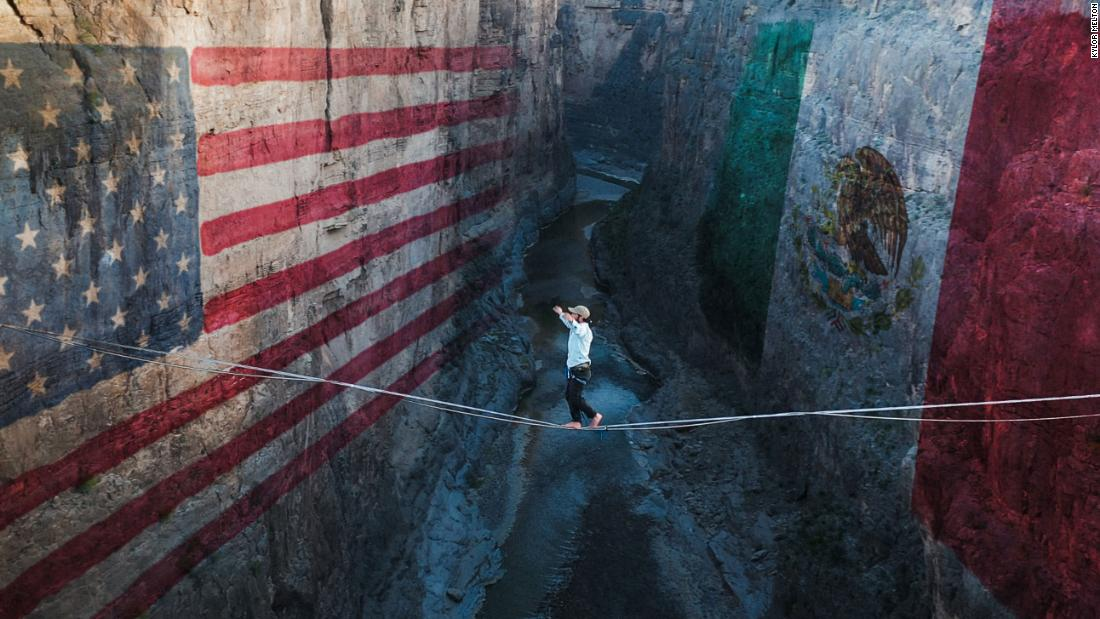 A Mexican and an American walked a highline hundreds of feet over the border to make a political point