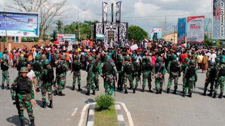 Indonesian soldiers stand guard during a protest in Timika in Papua province Wednesday.