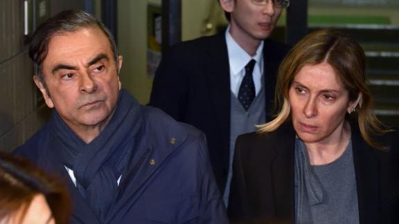 This picture taken on April 3, 2019 shows former Nissan Chairman Carlos Ghosn (2nd L) and his wife Carole (R) leave the office of his lawyer Junichiro Hironaka in Tokyo. - Former Nissan boss Carlos Ghosn will remain in custody until at least April 14, a Japanese court ruled on April 5, 2019, as prosecutors quiz him over fresh allegations of financial misconduct.