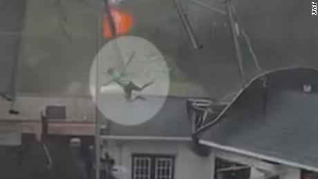 Storm winds threw a man onto a roof of a restaurant in Clemson, South Carolina.
