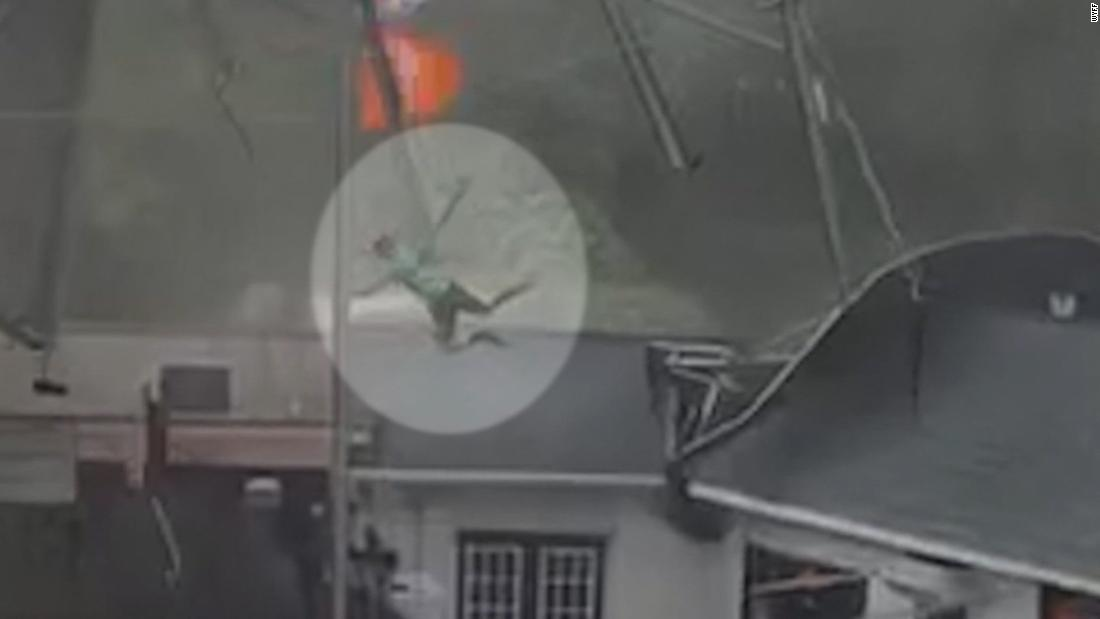 Strong winds send restaurant employee flying onto roof