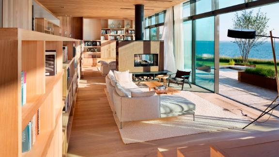 A 100-foot wall of glass allows for undisturbed views of the water in this home designed by Caleb Mulvena.