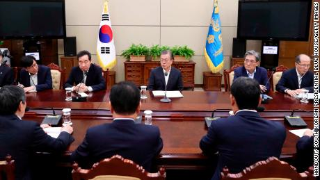 South Korean President Moon Jae-in listens to a report from officials related to the General Security of Military Information Agreement with Japan.