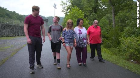 Jacob, Gabriel and Andrianna Riling on a walk with their 70- year-old grandparents, Beverly and Andrew Riling.