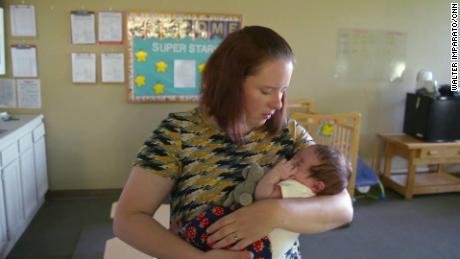 A caretaker to-7-week-old Oliveah.