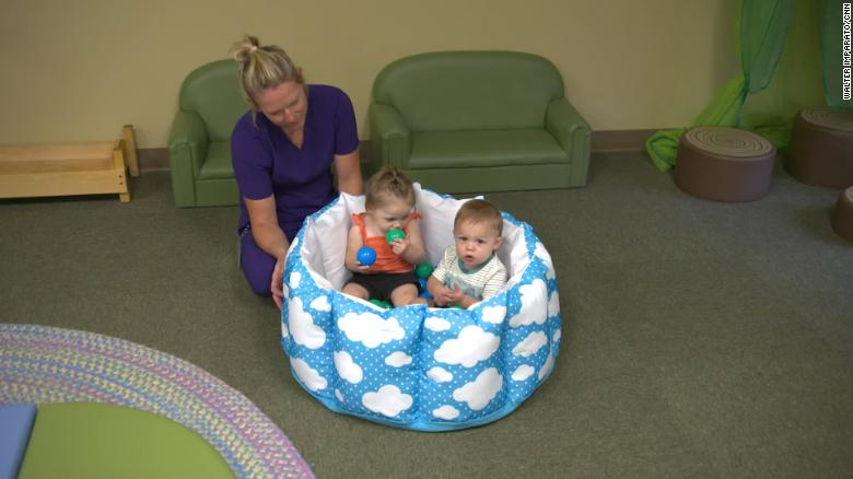 A daycare teacher cares for 11-month old twins.