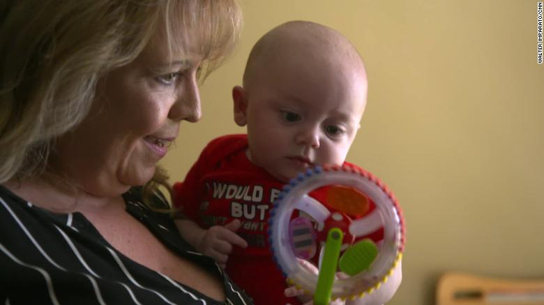 Janie Fuller-Phelps holds 4-month-old Huck.