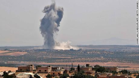 Smoke billows above buildings during a reported air strike by pro-regime forces on Khan Sheikhun in Syria's Idlib province on August 19, 2019. - A Turkish military convoy crossed into northwest Syria today, heading towards a key town where regime forces are waging fierce battles with jihadists and rebels. (Photo by Omar HAJ KADOUR / AFP)        (Photo credit should read OMAR HAJ KADOUR/AFP/Getty Images)