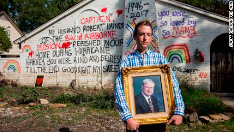 Kyle Haines stands in front of the remains of his house holding a photograph of his late husband Bob Haines, who died in their home during the flooding after Hurricane Harvey, in Houston, TX on Thursday, November 2, 2017. (Photo/Scott Dalton)