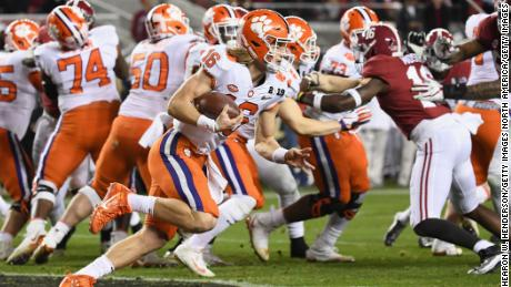 Trevor Lawrence (#16) of the Clemson Tigers takes off against the Alabama Crimson Tide in the CFP National Championship game.