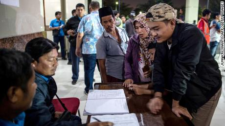Family members of passengers who were on board the MV Santika Nusantara waited Friday for information on their relatives at Tangjung Perak seaport in Surabaya, East Java.