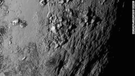 IN SPACE - JULY 14: In this material provided by the National Aeronautics and Space Administration (NASA), a close-up image of a region near Pluto. The equator shows a range of 3,500 meters (1100 feet) of mountains taken by NASA's New Horizons spacecraft as it passed 7,800 feet from the Dwarf planet on July 14, 2015. A 1050-pound piano probe , which was launched on January 19, 2006 aboard an Atlas V rocket from Cape Canaveral, Florida, zip from the planet yesterday. (NASA / APL / SwRI photo via Getty Images)