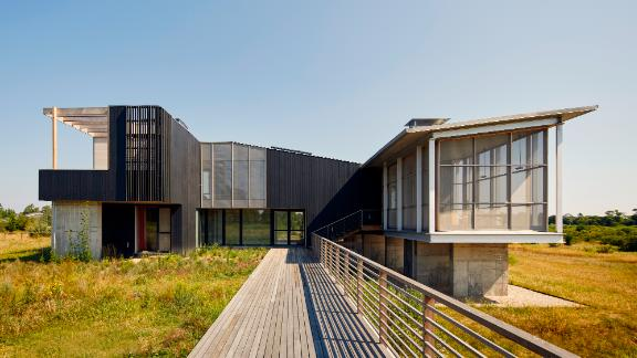 The Cohen's home was  designed to float above the wetlands meadow in Long Island's North Fork.