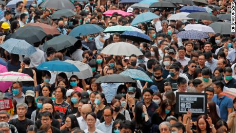 Hundreds of accountants march at Chater Garden, in Hong Kong, Friday, Aug. 23, 2019. Protesters demand to fully withdraw the extradition bill and set up an independent committee to investigate the use of force by Hong Kong police. (AP Photo/Kin Cheung)