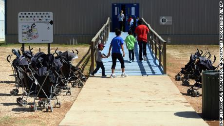 FILE - In this Aug. 9, 2018, file photo, provided by U.S. Immigration and Customs Enforcement, immigrants walk into a building at South Texas Family Residential Center in Dilley, Texas. A complaint expected to be filed Thursday, Aug. 23 with the Department of Homeland Security alleges that immigration authorities coerced dozens of parents separated from their children at the border to sign documents they didn't understand. In some of those cases, parents gave away rights to be reunited with their kids. The complaint will be filed by the American Immigration Lawyers Association and the American Immigration Council. (Charles Reed/U.S. Immigration and Customs Enforcement via AP, File)