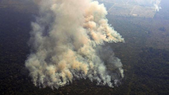 Aerial picture showing smoke from a two-kilometre-long stretch of fire billowing from the Amazon rainforest about 65 km from Porto Velho, in the state of Rondonia, in northern Brazil, on August 23, 2019. - Bolsonaro said Friday he is considering deploying the army to help combat fires raging in the Amazon rainforest, after news about the fires have sparked protests around the world. The latest official figures show 76,720 forest fires were recorded in Brazil so far this year -- the highest number for any year since 2013. More than half are in the Amazon. (Photo by Carl DE SOUZA / AFP)        (Photo credit should read CARL DE SOUZA/AFP/Getty Images)