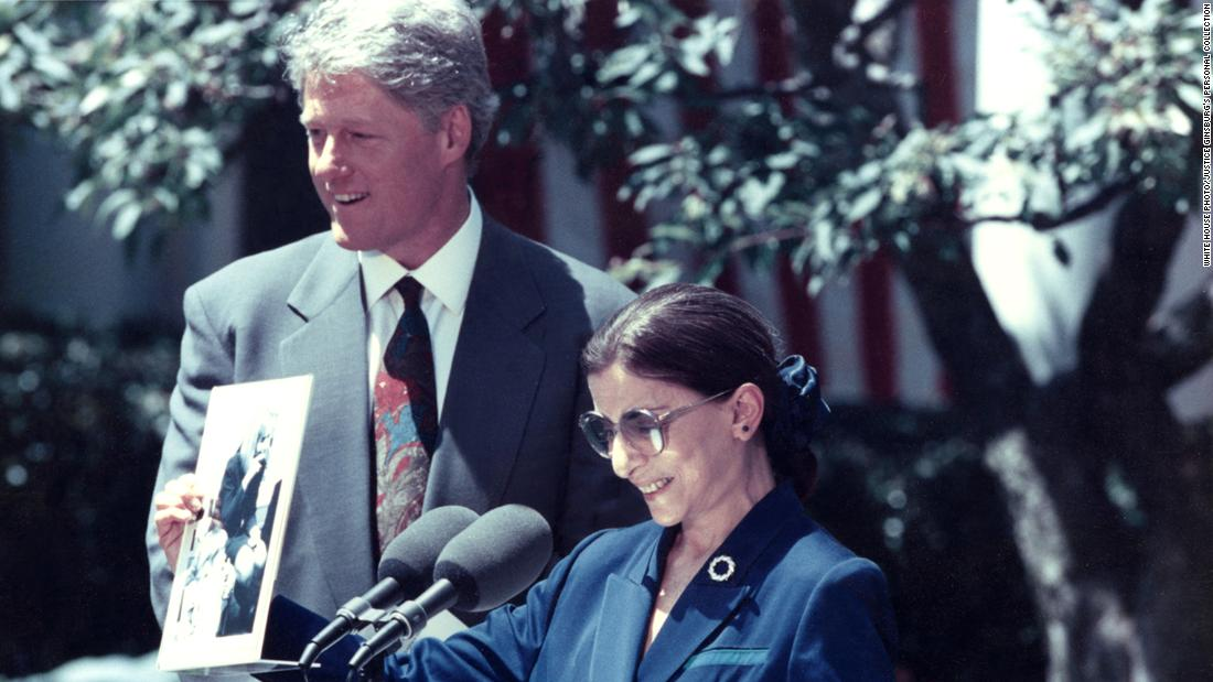 "President Bill Clinton nominated Ginsburg to the US Supreme Court in June 1993. Here, Ginsburg is holding a photograph of Hillary Clinton singing ""the toothbrush song"" with Ginsburg's granddaughter Clara and her nursery school class."