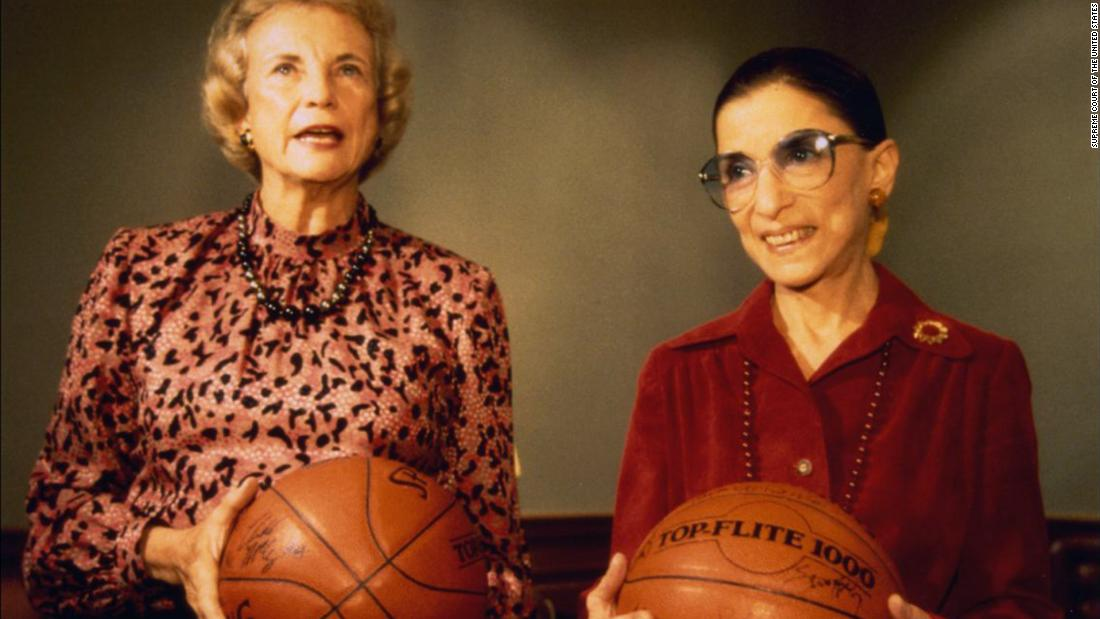 Ginsburg and fellow Justice Sandra Day O'Connor hold basketballs given to them by the US women's basketball team in December 1995.