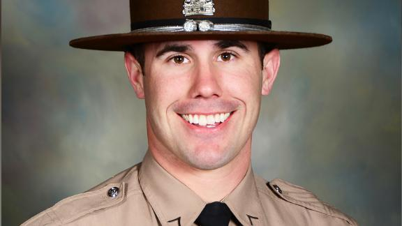 Nicholas Hopkins, an Illinois State Trooper who was shot while executing a warrant, died Friday night, according to Director of the Illinois State Police Brendan Kelly.