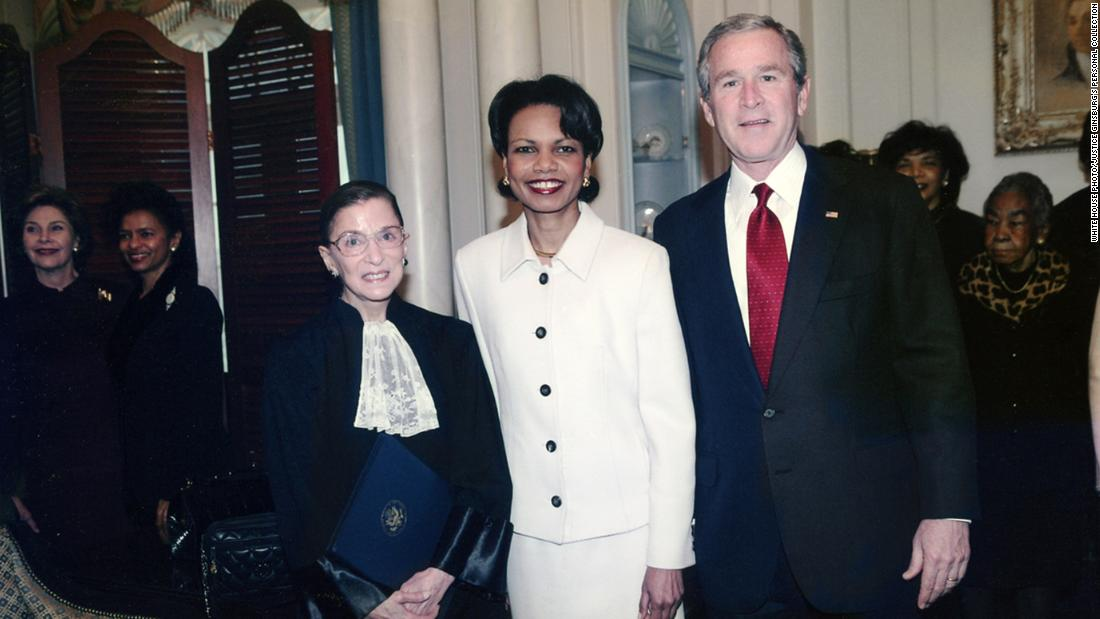 Ginsburg poses with President George W. Bush and Secretary of State Condoleezza Rice in January 2005. Ginsburg swore Rice in.