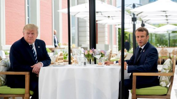 U.S President Donald Trump sits for lunch with French President Emmanuel Macron, right, at the Hotel du Palais in Biarritz, south-west France, Saturday Aug. 24, 2019. Efforts to salvage consensus among the Group of Seven rich democracies on the economy, trade and environment were fraying around the edges even as leaders were arriving before their three-day summit in southern France. (AP Photo/Andrew Harnik)